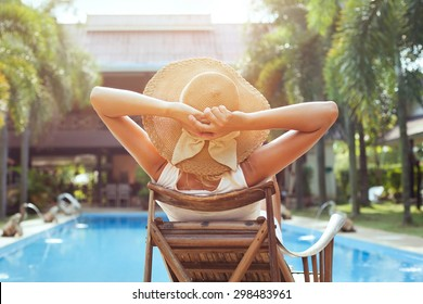 woman relaxing in luxury hotel, summer holidays