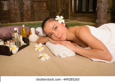 The woman is relaxing with massage and aromatherapy.