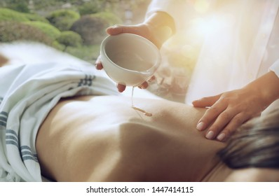 Woman relaxing with a massage in a spa center. Double exposure