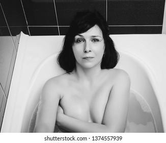 Woman relaxing in modern bath
