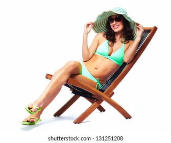 Woman relaxing on the beach. Isolated on white.