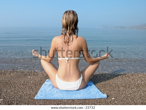 woman relaxing on the beach in the morning light
