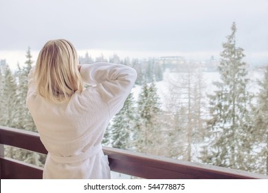 Woman relaxing on beautiful view of winter forest
