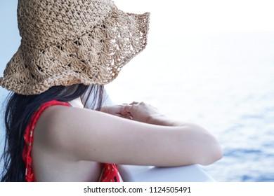 woman relaxing on Cruise ship enjoying ocean view from  balcony