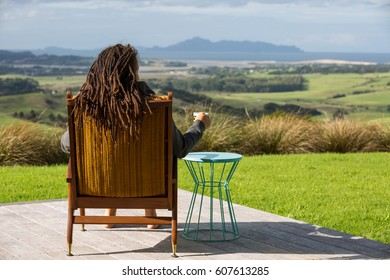 Woman relaxing on outdoor house terrace