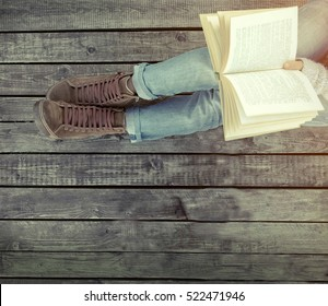 Woman relaxing on the pier and reading book
