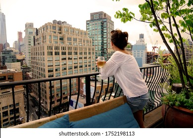 Woman relaxing on rooftop in New york city, evening light