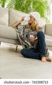 woman relaxing on sofa with phone
