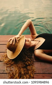 Woman relaxing on a wooden jetty