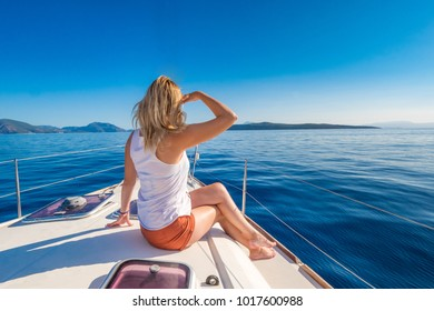 Woman relaxing on a yachting trip at the sea on the Greece coastline