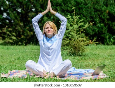 Woman relaxing practicing meditation. Every day meditation. Reasons you should meditate every day. Find minute to relax. Clear your mind. Girl meditate on rug green grass meadow nature background.