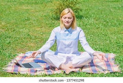 Woman relaxing practicing meditation. Every day meditation. Reasons you should meditate every day. Clear your mind. Girl meditate on rug green grass meadow nature background. Find minute to relax.