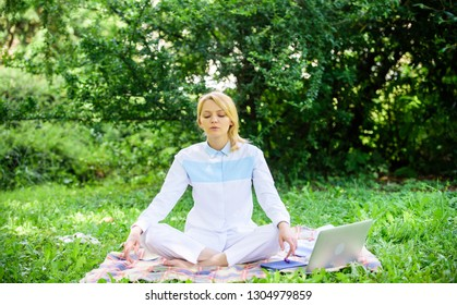 Woman relaxing practicing meditation. Reasons you should meditate every day. Find minute to relax. Clear your mind. Girl meditate on rug green grass meadow nature background. Every day meditation.