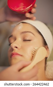 Woman relaxing in spa, facial cleaning