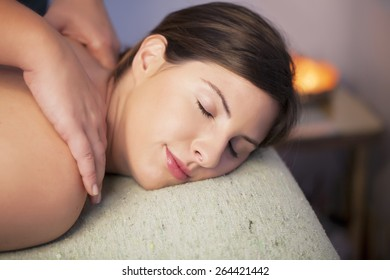 Woman relaxing in spa receiving massage
