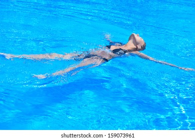 Woman is relaxing in swimming pool