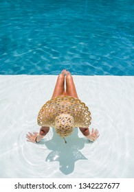 Woman relaxing in swimming pool at spa resort. relaxing concept.