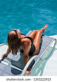 Woman relaxing in swimming pool at spa resort. relaxing concept. - UNRETOUCHED body.