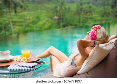Woman relaxing in tropical villa
