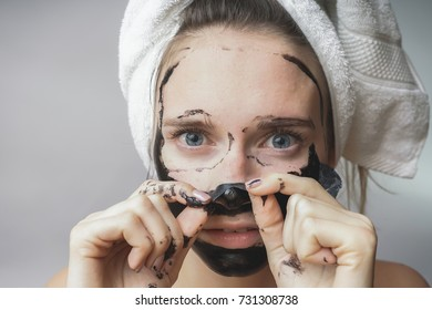 Woman remove black mask,good results. Face scrub ,exfoliation pores, clean skin