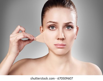 Woman remove her old dry skin from face.