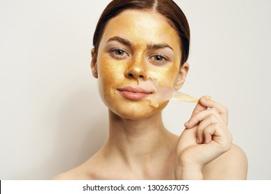 woman removes cosmetic mask