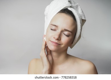 Woman removes cosmetics with cotton swab, cleaning face
