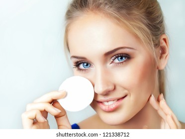 Woman removing applyed makeup