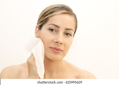 Woman removing makeup with wipes