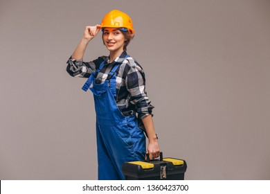 Woman repairer in uniform with tool box