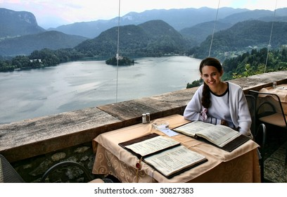 Woman in the restaurant of Castle Bled, overlooking Lake Bled, Slovenia