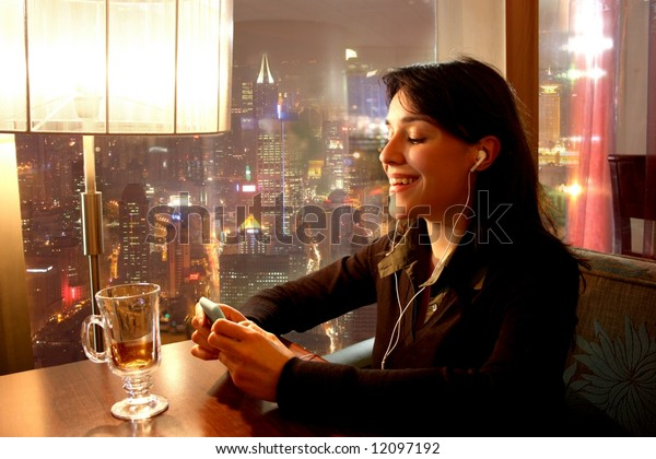 a woman at the restaurant with a mp3 player