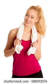 Woman resting after fitness workout with towel around her neck isolated over white.