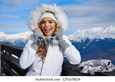 Woman resting after a winter sports on the terrace of the resort.
