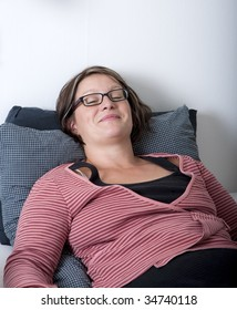 Woman resting in bed, she have a nice smile