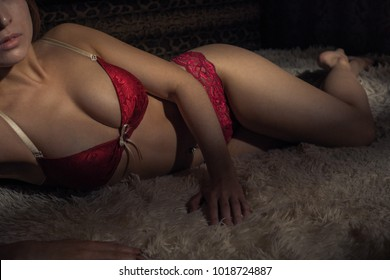 Woman resting in the evening in sexy lingerie on the bed