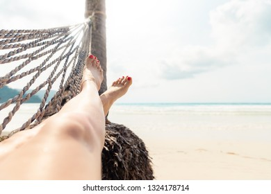Woman Resting in a Hammock on a Tropical Background. Sea and Rest. Journey. Holiday