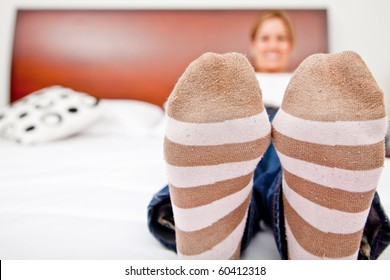 Woman resting and lying on the bed - focus on feet