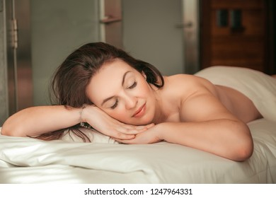 woman resting on a massage table