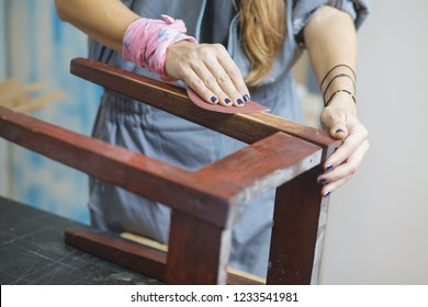 woman restoring furniture