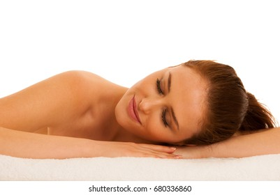woman rests on white towel - conceptual photo for skin care and spa