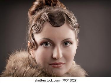 Woman retro revival portrait.girl in boa