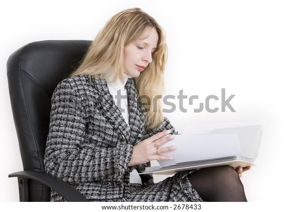A woman reviewing documents in a folder