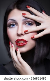 woman with rhinestones on her lips and nails