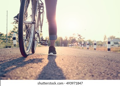 Woman ride bike on the summer road, Activities for keeping healthy, Concept of recreation