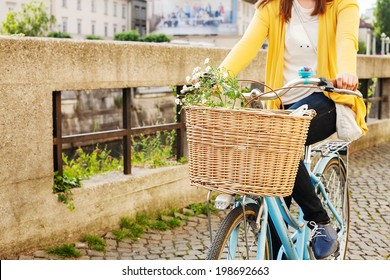 Woman riding bicycle with flowers