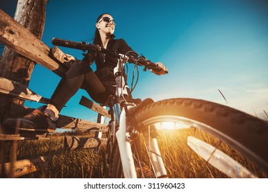 Woman is riding bicycle outside
