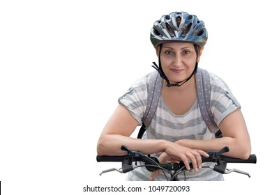 Woman riding a bicycle. Portrait of happy middle aged female 40 45 50 years old wearing a bike helmet.