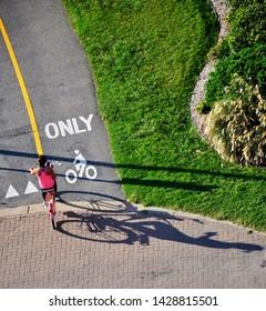 Woman riding bike on a separated bike lane