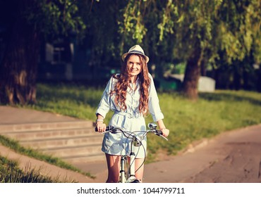woman riding a bike on the summer park